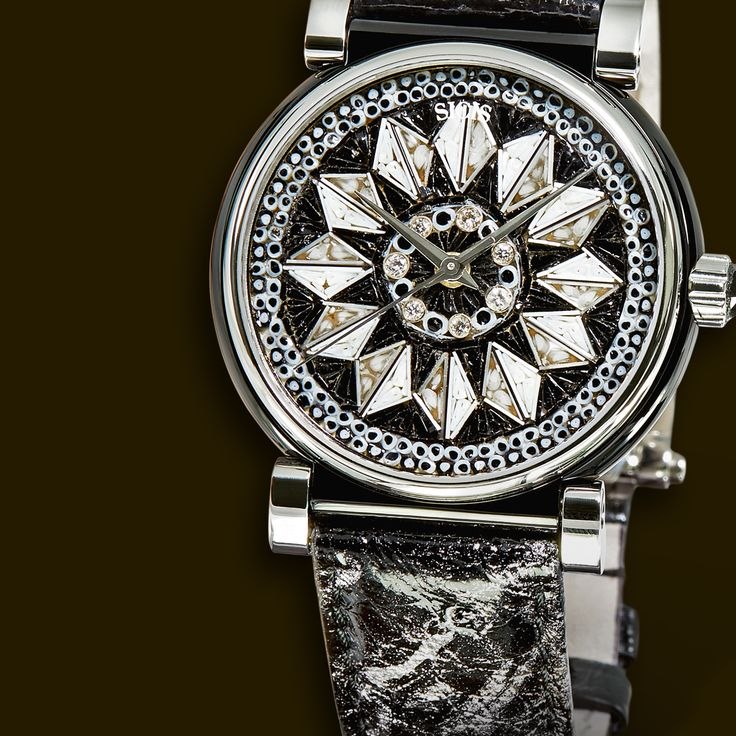 Cool pattern for a cool man, our Pluma watch in steel and diamond, with ostrich strap is a true beauty.