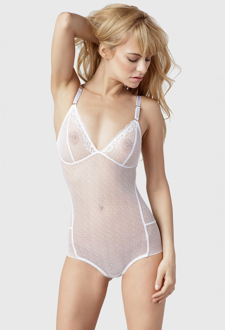 Fortnight Lingerie's Ruby Bodysuit is constructed with sheer, supremely soft French lace, creating bold opaque seams that highlight the careful tailoring and detail of each body contouring curve.