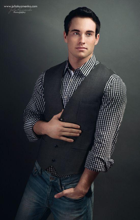 black gingham shirt, vest, jeans