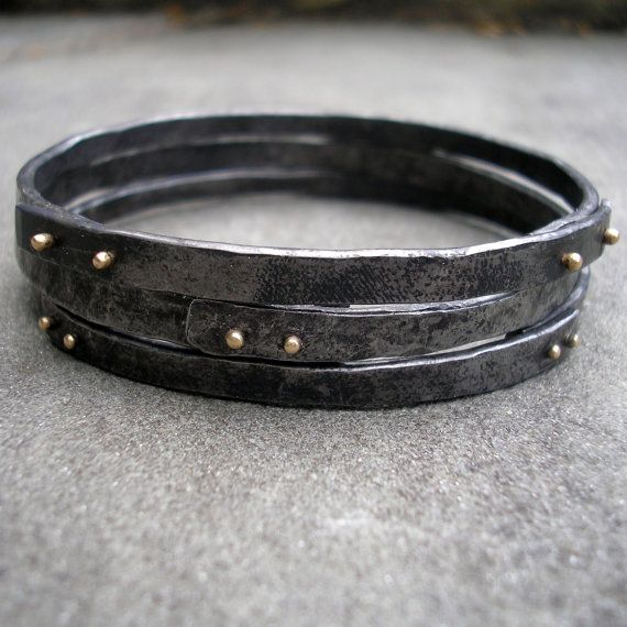 Gold and Steel Bracelets.  Riveted Stacking Bangles of Forged Steel and 18 KT Gold. L. Sue Szabo