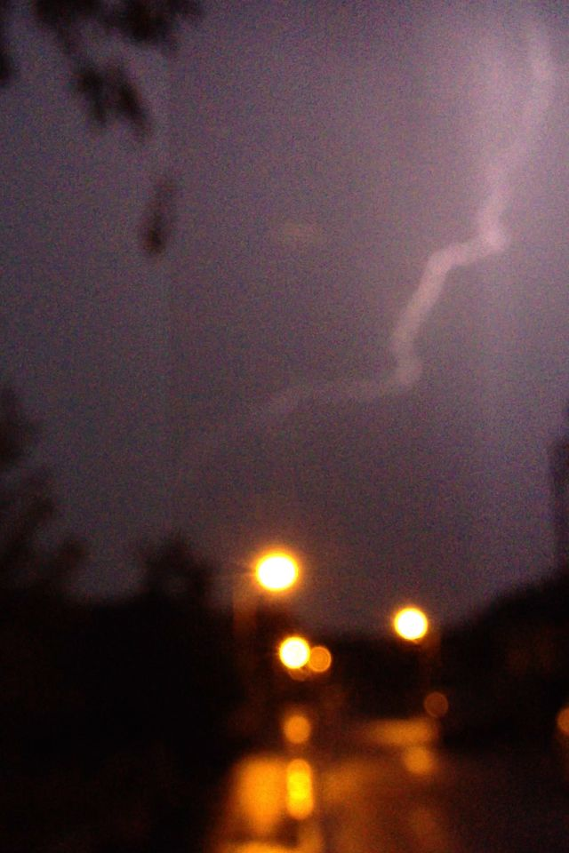 Some blurry lightning. There was some great thunder and lightning in Nottingham this evening. lightning is an electric current, it's caused by a build up of electric charges in the cloud. Positive charges build up at the top of the cloud and negative charges at the bottom. This causes a positive charge to build up on the ground below. When the charges coming up from the ground reach those coming down from the clouds lightning strikes!