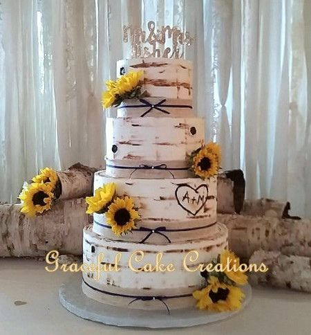 Birch Bark Wedding Cake accented with Burlap and Lace and Sunflowers