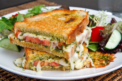 Caprese Grilled Cheese... Basil pesto, mozzarella, tomato, butter & bread. Need I say more?