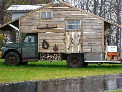 I am thinking I need to build me a log cabin on wheels like this ...