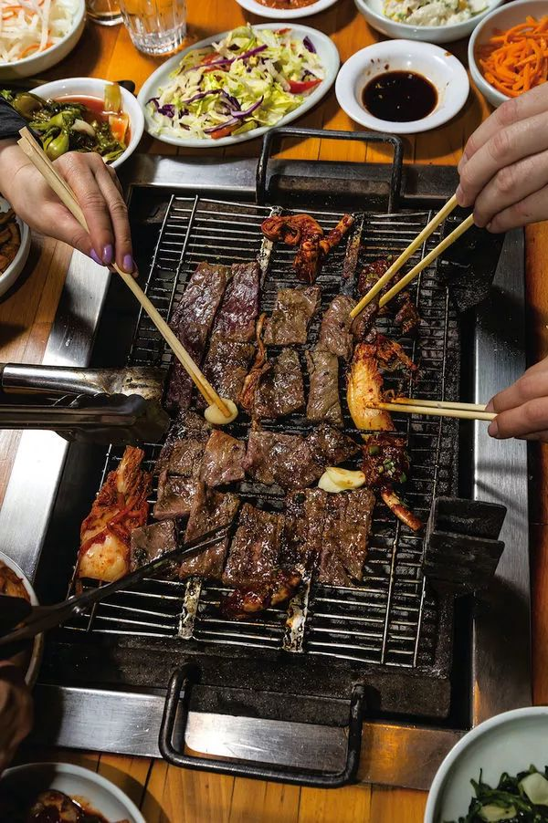Pineapple juice sweetens and tenderizes beef short ribs in this classic Korean grilled dish. Ask your butcher for bone-in short ribs cut in half crosswise.