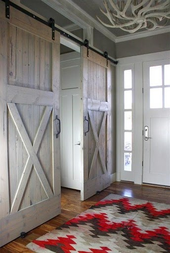 for the cabin! Beautiful sliding barn doors. Neat antler ceiling hanging.