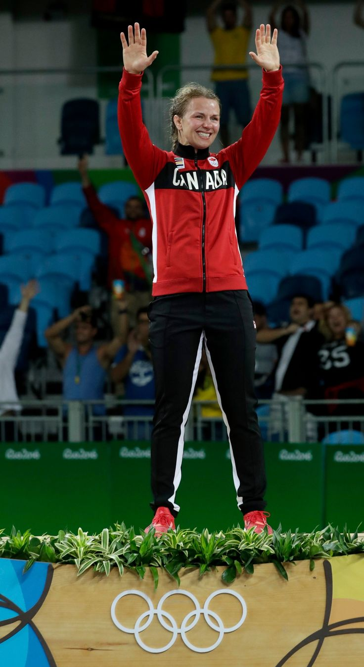 Canada's Erica Elizabeth Wiebe stands on the podium after winning the gold in the women's wrestling freestyle 75-kg competition at the 2016 Summer Olympics in Rio de Janeiro, Brazil, Thursday, Aug. 18, 2016. (AP Photo/Charlie Riedel)