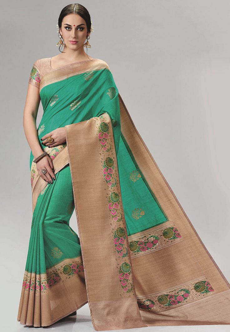 Art Bangalore Silk Saree in Teal Green Beautifully woven with Resham and Zari Available with an Unstitched Art Silk Blouse in Beige Free Services: Fall and Edging (Pico) Do note: Accessories shown in the image are for presentation purposes only.(Slight variation in actual color vs. image is possible.)