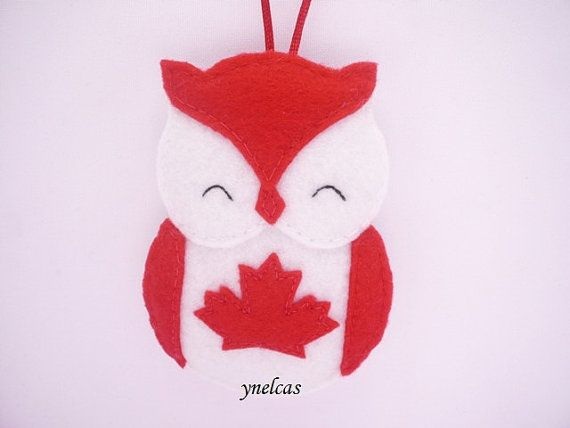 Red and white felt Owl Canada ornament.  An original and unique ornament for decorations of your Christmas tree, hanging from the rearview mirror of your car, or to add a touch of whimsy to any corner of your home.  This listing is especially for people who love, admire or just like to collect items of Canada. • felt in red and white • 4 x 3 (10.2 x 7.6 cm) (not including the ribbon loop) • stuffed with polyester fiberfill • no glue is used • each owl is 100% handmade (hand cut + hand sewed…