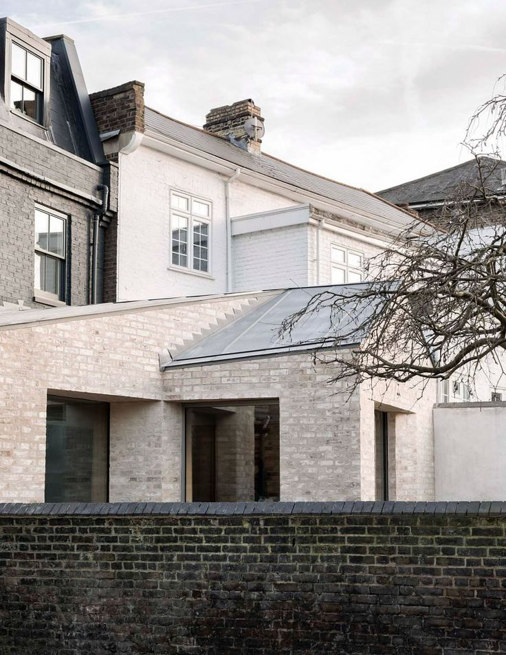 McLaren Excell adds pale-brick extension to black-painted Victorian house