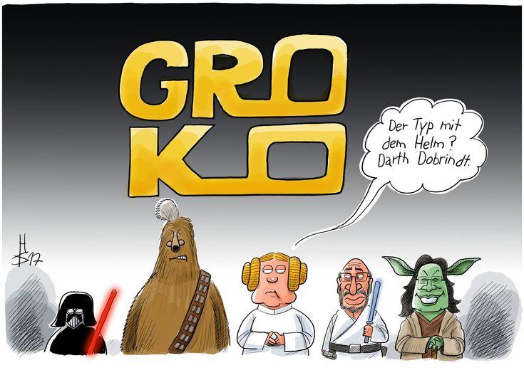 """Merkel, Seehofer, Schulz und Nahles tragen Star Wars-Kostüme. Merkel fragt """"Der Typ mit dem Helm? Darth Dobrindt """" und schaut zu einer kleinen Darth Vader-Figur neben Seehofer."""