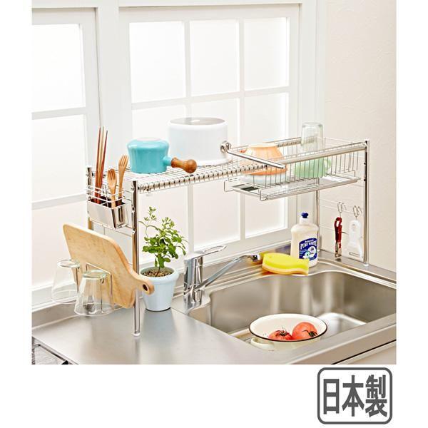 蛇口上の空間をフル活用!片付け上手な突っ張りラック。調理中の包丁やザルのチョイ置きや、コップの水切りに便利なマルチラック。棚の高さが調節でき、トレイを棚の上に置けば、調味料も収納できます。突っ張り式なので、安定性も◎。フキン掛け、箸&まな板立て、フック3個付。(検索用)08z220※このページは2段のみのページです。幅55.5(箸たて含む)・奥行18cm・高さ69~110cm 〔棚・フキン掛け・箸立て・まな板立て・フック〕18-8ステンレス〔トレー〕18-0ステンレス〔支柱〕スチール(クロームメッキ)〔樹脂部品〕ABS樹脂※〔セット内容〕トレー用棚2個・トレー2枚・フキン掛け1個・箸立て1個・まな板立て1個・フック3個※まな板ホルダーは厚さ10mm以下のまな板に対応●日本製※組立式※日時指定不可