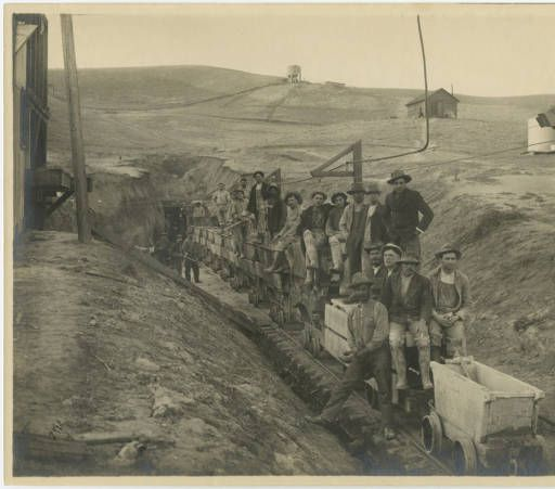 "Photograph of the ""North Port Crew,"" workmen digging a tunnel for construction of the Los Angeles Aqueduct, ca. 1908. Catherine Mulholland Collection. San Fernando Valley History Digital Library."