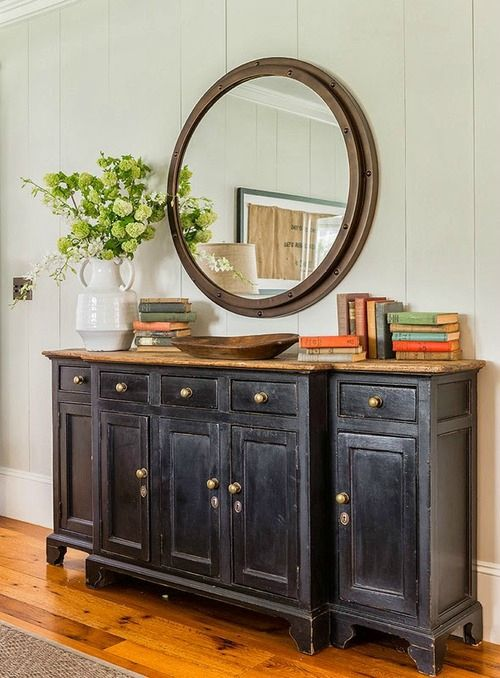 sideboard with round mirror