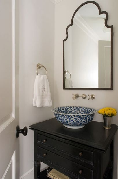 Suzie: Jennifer Davis Interior Design - Small, chic powder room with black repurposed chest ...