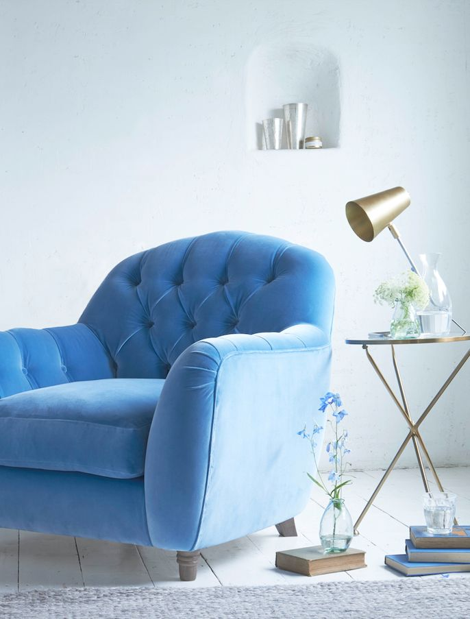 Loaf's deep-buttoned Butterbump armchair in blue velvet love this blue velvet against a pale wall