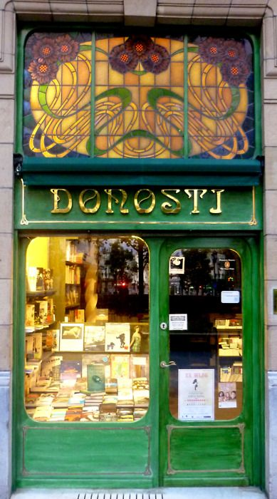 stained glass art nouveau entrance for bookstore...what a large and impressive piece of vintage stained glass!!