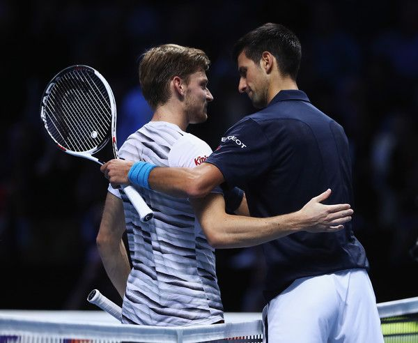 David Goffin Photos Photos - Novak Djokovic of Serbia is congratulated by David Goffin of Belgium after their men's singles match on day five of the ATP World Tour Finals at O2 Arena on November 17, 2016 in London, England. - Day Five - Barclays ATP World Tour Finals