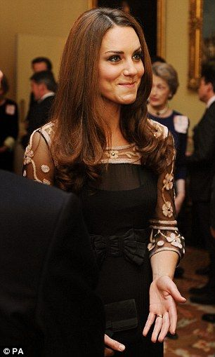 Effortlessly beautiful: The Duchess of Cambridge looked elegant in a black gown by Alice Temperley..Such a cute expression!