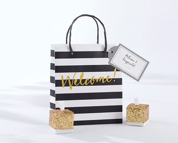 Greet guests with elegantly classic welcome bags filled with snacks, emergency kits, and a local guide. | Classic Black And White Striped Welcome Bags (Set of 12)