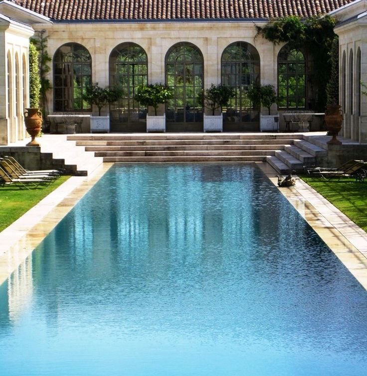 Traditional Reflecting Pool Proportions are used for a Swimming Pool and Gardens in this Italian Estate.