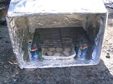 Here's 3 different ways to make a cardboard box oven.  It's easy, inexpensive, and works as well as your oven at home.  All you need is the foil, grate, cans, and a box.  And, you can for-go the box, if you so choose!