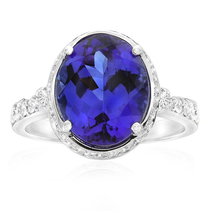 Rare and beautiful. Kilimanjaro tanzanite and diamond dress ring. This oval cut tanzanite is a deep bluish-purple colour. Crafted in 18ct white gold. This ring will be customised to perfectly fit your finger, which may take up to 6 weeks
