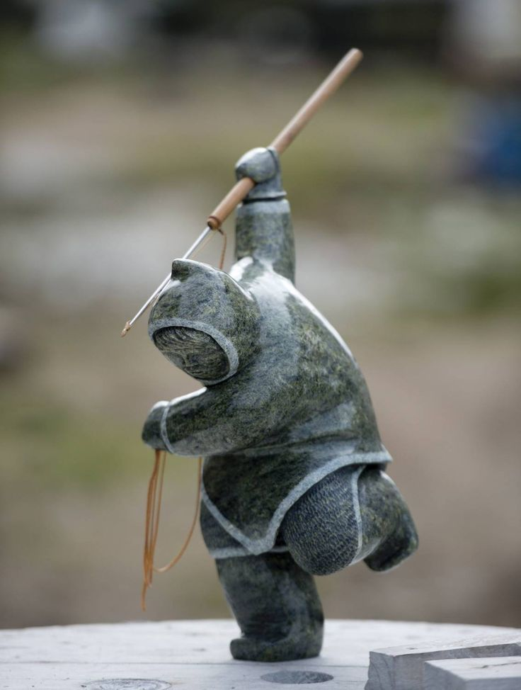 Images capture Inuit stone carver Archie Ishulutak at work - The Globe and Mail