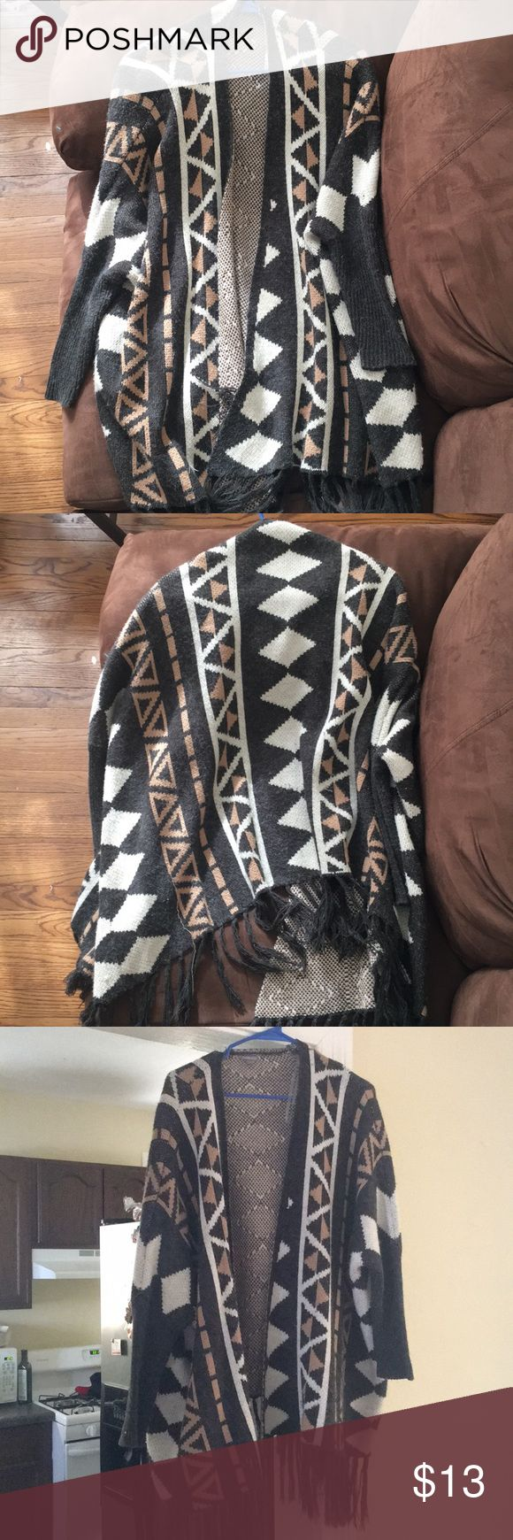 S/M Charlotte Russe tribal print cardigan Grey, camel and cream accented patterns. Small/medium in size. Fringe accents on the bottoms of the cardigan. Extremely warm and comfy— perfect for the cold months! Charlotte Russe Sweaters Cardigans