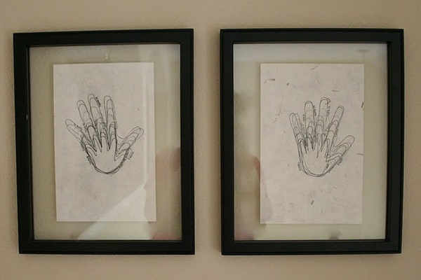 Trace their hand on their birthday every year on the same paper. (It will make you cry. They grow up so fast!) family