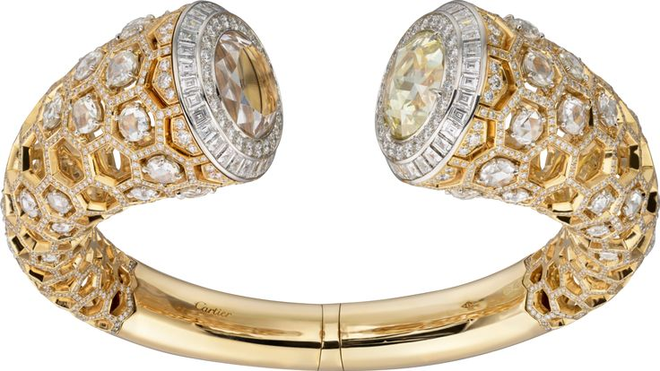 """CARTIER. High Jewellery """"Honeycomb"""" visible hour watch, mechanical movement with manual winding, calibre Cartier 8971 MC. Yellow gold and platinum case, one round-shaped rose-cut diamond of 7.31cts, 1,721 brilliant-cut diamonds totaling 6.42cts, 60 rose-cut diamonds totaling 6.61cts, 60 princess-cut diamonds totaling 3.62cts, translucent lacquered golden sunray effect dial, rhodium-finish white gold sword-shaped hands. Water-resistant to 3 bar (approx. 30 meters). Unique piece. #2016"""