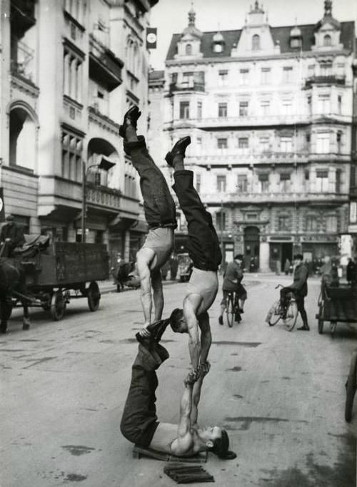 Vintage Street Performers: Acrobats performing on the streets of Berlin, Germany. Circa 1933.