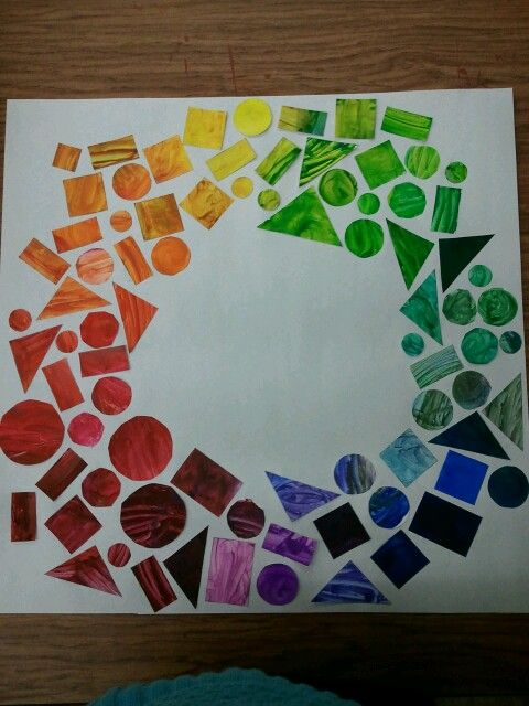 Art lesson: Kindergarteners experiment with mixing colors together and you cut the colors out in shapes and form a color wheel!  It looks beautiful!