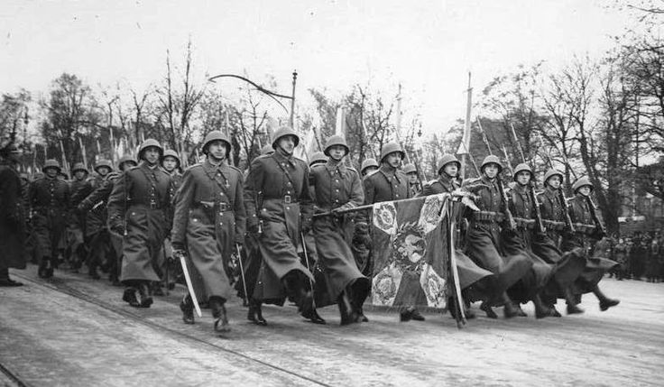 Officers and enlisted infantrymen of the Polish Army marching down Ujazdów Avenue in Warsaw at the 1938 Polish Independence Day Parade.