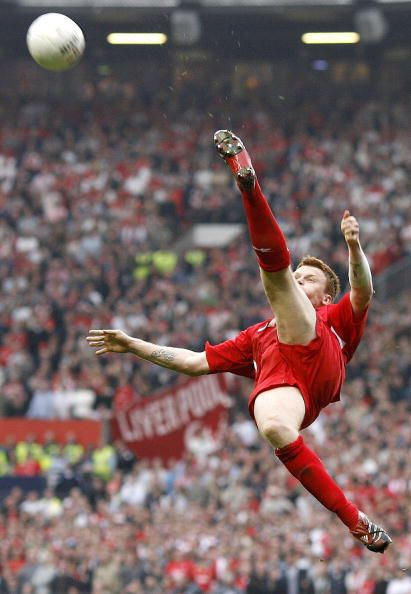 Liverpool's John Arne Riise kicks the ball as he plays against Chelsea during an FA Cup semifinal game at Old Trafford in Manchester 22 April 2006...
