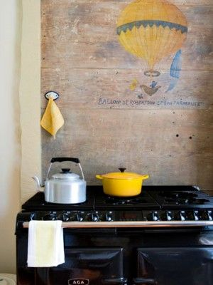 black Aga and hand-painted French-inspired wall
