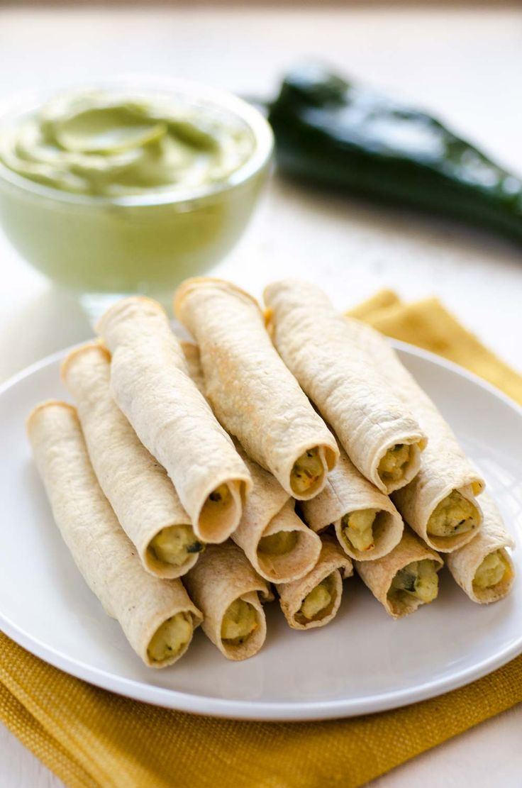 These Mashed Potato and Poblano Flautas from Salud Vegan Mexican Cookbook are golden, crispy, filled with creamy mashed potatoes and poblano.