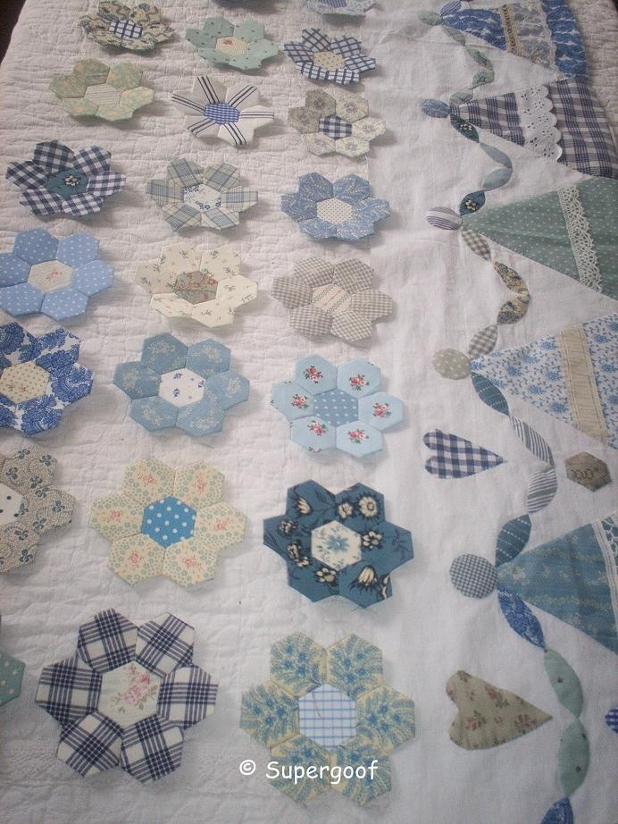 pretty blue hexy flowers and sweet little girl border, love this quilt already