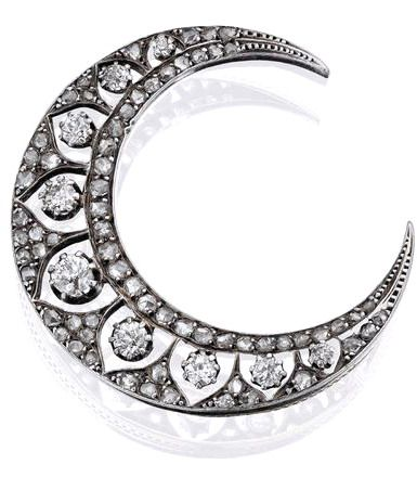 A diamond crescent brooch, French, circa 1900 Set with a graduated row of nine old round brilliant-cut diamonds within openwork epaulets, the surrounding crescent frame set throughout with rose-cut diamonds, mounted in silver on gold, length 42mm, French assay mark, the old round brilliant-cut diamonds estimated to weigh approximately 1.05cts in total