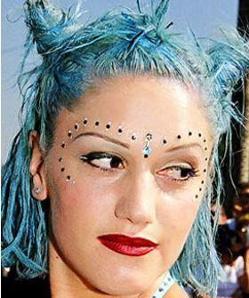 Gwen Stefani - blue hair and bindi era. Out of shot is the amazing blue faux fur bikini top...