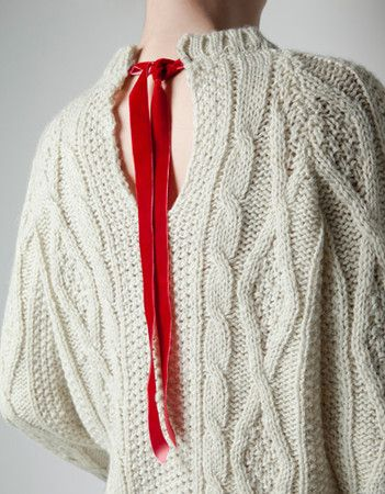 ZARA : sweater with bow at the back    Or could split shoulder seams, 1 or both, then do ribbon ties.