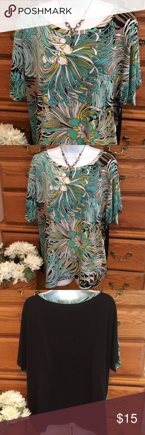 "Van Heusen Tropical Shirt . 95% polyester and 5% spandex.  Very good condition.  Feels like a liquid knit and really doesn't wrinkle. 👍 Approximately 26"" in length and when measured laid flat from armpit to armpit it is 25"" across.  Has stretch.  Kind of a little batwing style, bigger fit.  Colors are a solid black back with a green, white and yellow tropical pattern in the front of the top only.  Has a real pocket in the front too. Made in the USA. Van Heusen Tops Blouses"