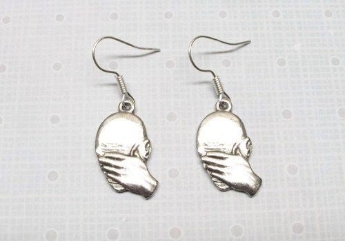 Facepalm Earrings :)  http://www.artfire.com/ext/shop/product_view/7815860