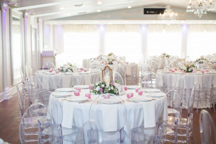 Clear chairs with crisp white linens and pops of pink and purple | Selecting Your Virginia Wedding Venue | Entwined Events | Venue: The Bedford Columns in Bedford, VA | Photo Credit: Alison Elizabeth Photography