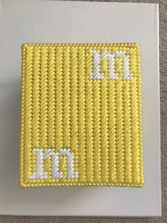 handmade to order -M&M Tissue Box Cover -item is cut out of plastic canvas and is stitched with acrylic yarn -one side will come with face stitched onto in; the other 3 sides will come with 2 Ms on them as will the top of the cover. -box will be made in one color of choice either: