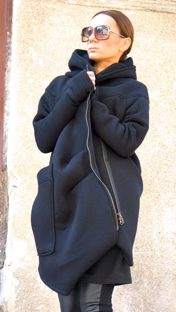 Gorgeous Hooded Black Quilted Coat / Extra Long sleeves Thumb Holes / Cotton Lined Inside  Extravagant and Unique Black Asymmetrical Coat  With Double Sided Zipper and large pocket , one inside dipper pocket ....so comfortable and always in Style!  Be Modern and Elegant and DARE to WEAR!  Different sizes available XS,S,M,L,XL,XXL,3XL,4XL   Fabric  outer part : cotton fleece lining : viscose YKK double sided zipper   This model is wearing size XS and is 55 tall  Measurements ( measur...