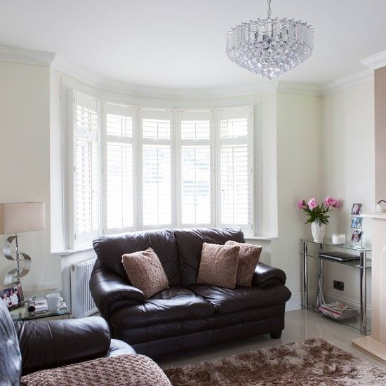 Pretty Living Room With Shuttered Bow Window