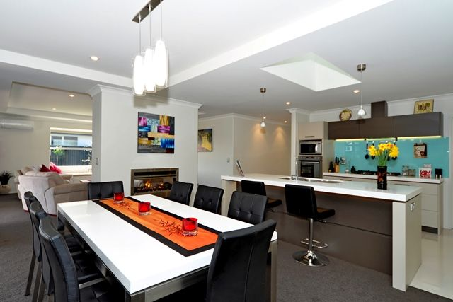 The double-sided fireplace is a favourite feature of the owner, bringing ambience to both the lounge and dining room.