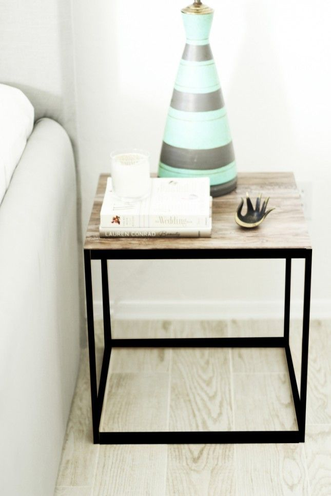 21 IKEA Nightstand Hacks Your Bedroom Needs via Brit + Co. Adhesive paper gives this top a reclaimed wood effect. Ikea doesn't make this any longer but Target has a very similar side table.