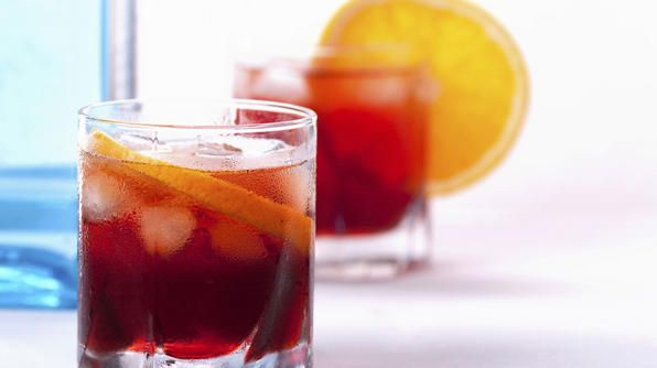 """A popular """"aperitivo"""" in Italy, a negroni is made of gin, sweet vermouth and Campari. Many restaurants and bars in Italy serve a buffet of free food to snack on while you enjoy a predinner cocktail."""
